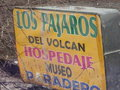 Hostel sign marooned by lahar.jpg